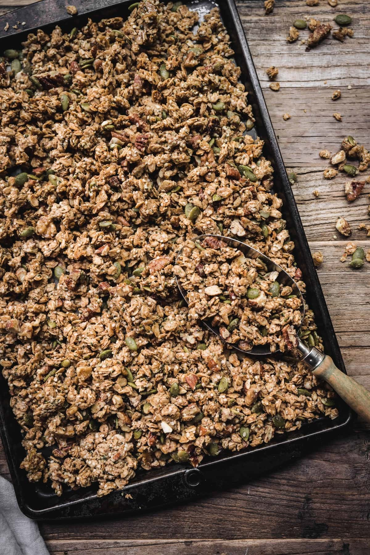 Overhead view of best easy gluten-free granola on an antique sheet pan