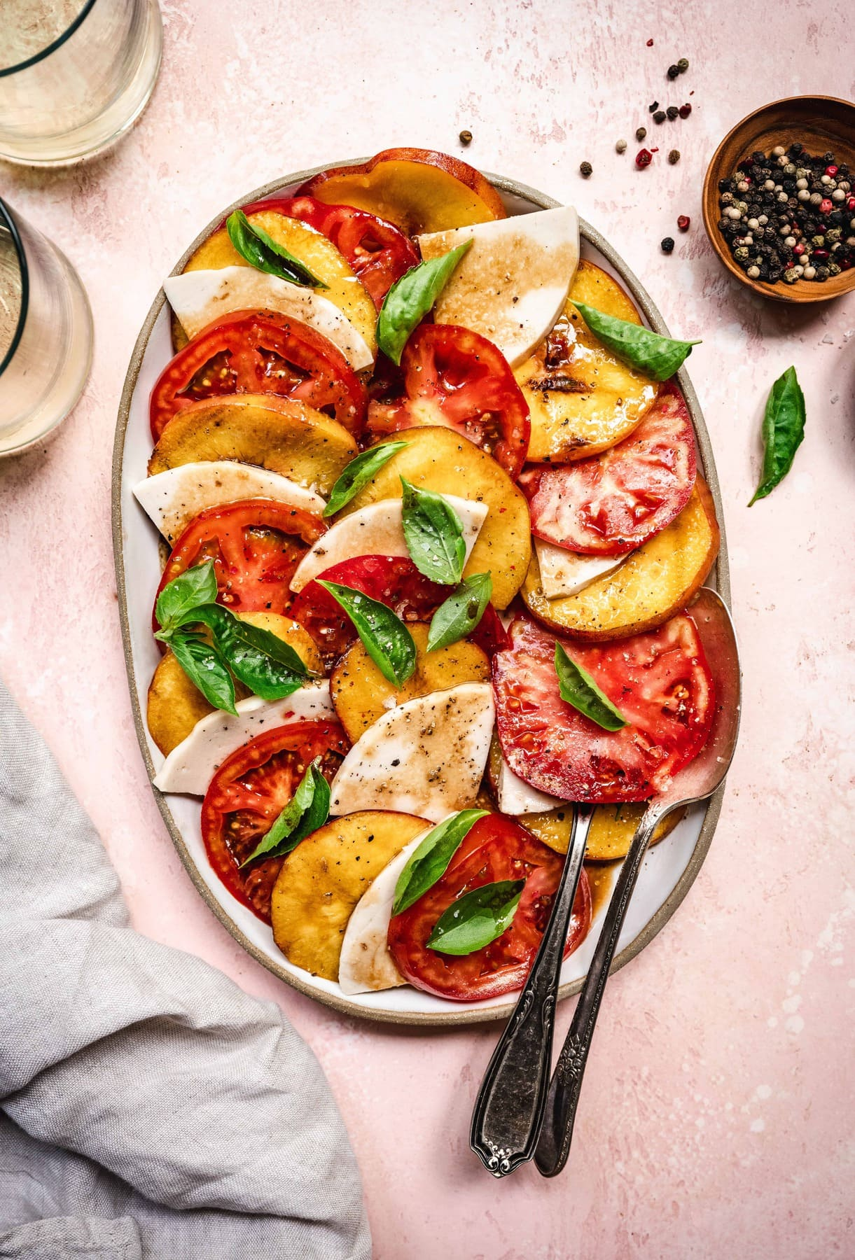 overhead of vegan grilled peach caprese salad with balsamic dressing