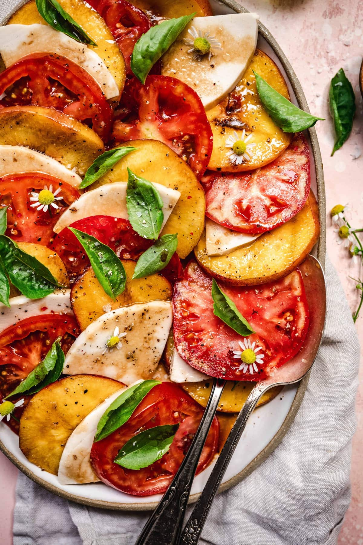 overhead of grilled peach caprese with dairy-free mozarella and balsamic dressing