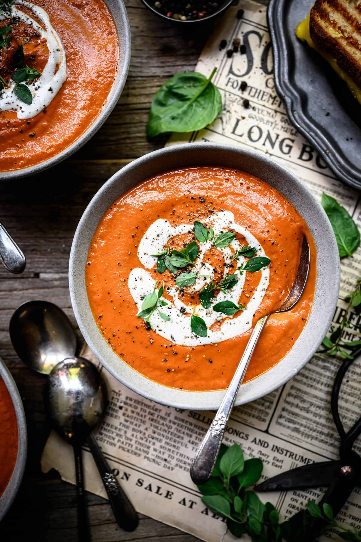 overhead of a bowl of creamy vegan tomato soup with cashew cream swirl