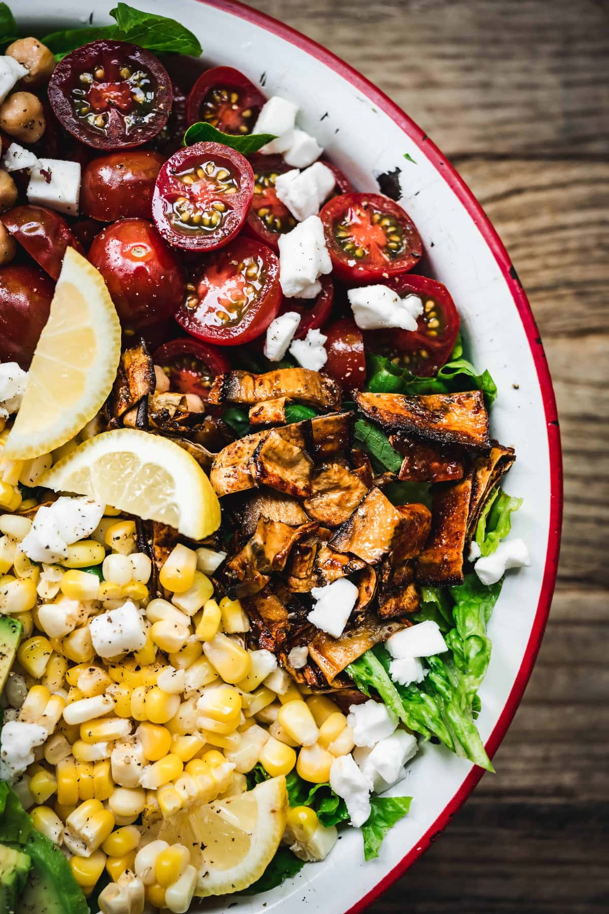 overhead of vegan cobb salad with eggplant bacon and homemade ranch dressing