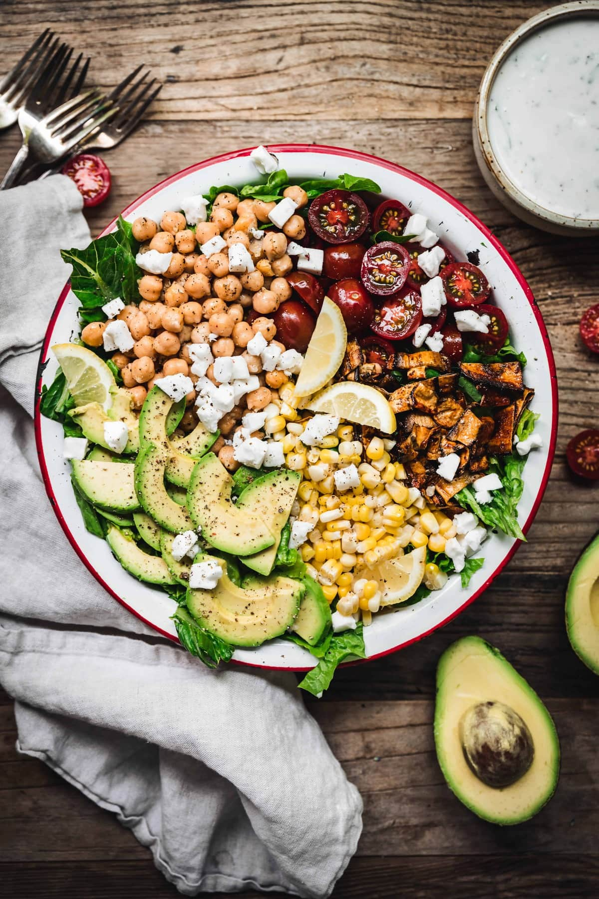 overhead of colorful vegetables in a vegan cobb salad with eggplant bacon and homemade vegan ranch dressing