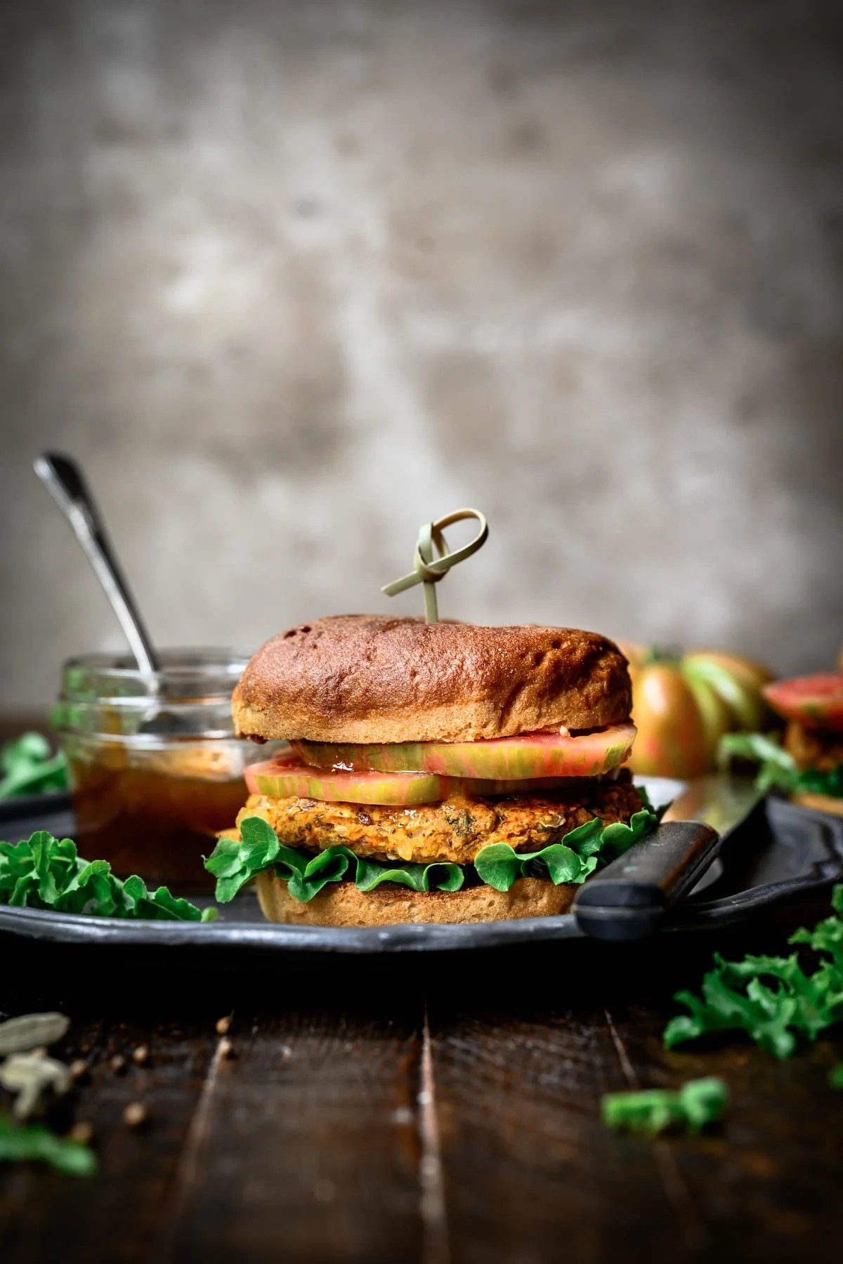 side view of indian-spiced veggie burger with mango chutney