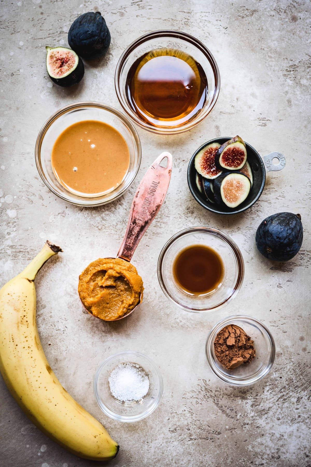 overhead view of toppings for vegan pumpkin peanut butter oatmeal recipe