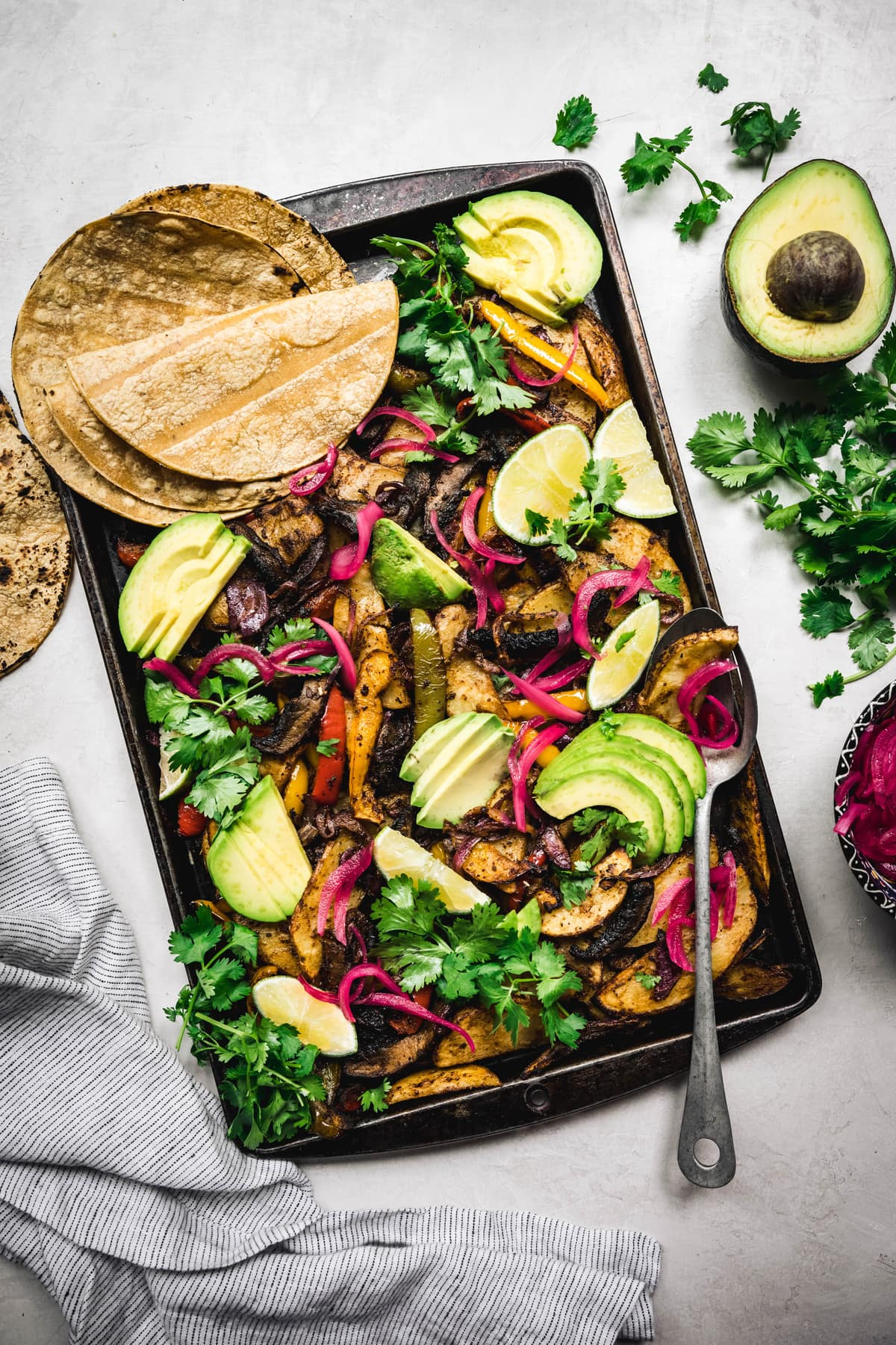 overhead of vegan portobello sheet pan fajitas with corn tortillas