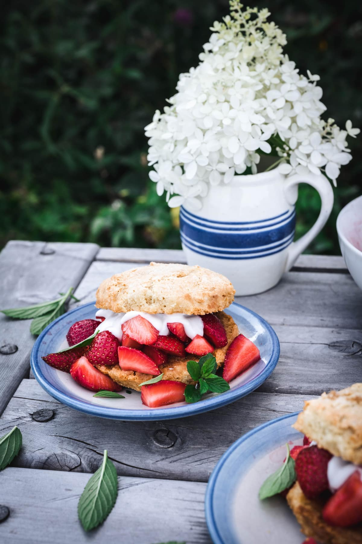 side view of vegan strawberry shortcakes on outdoor table
