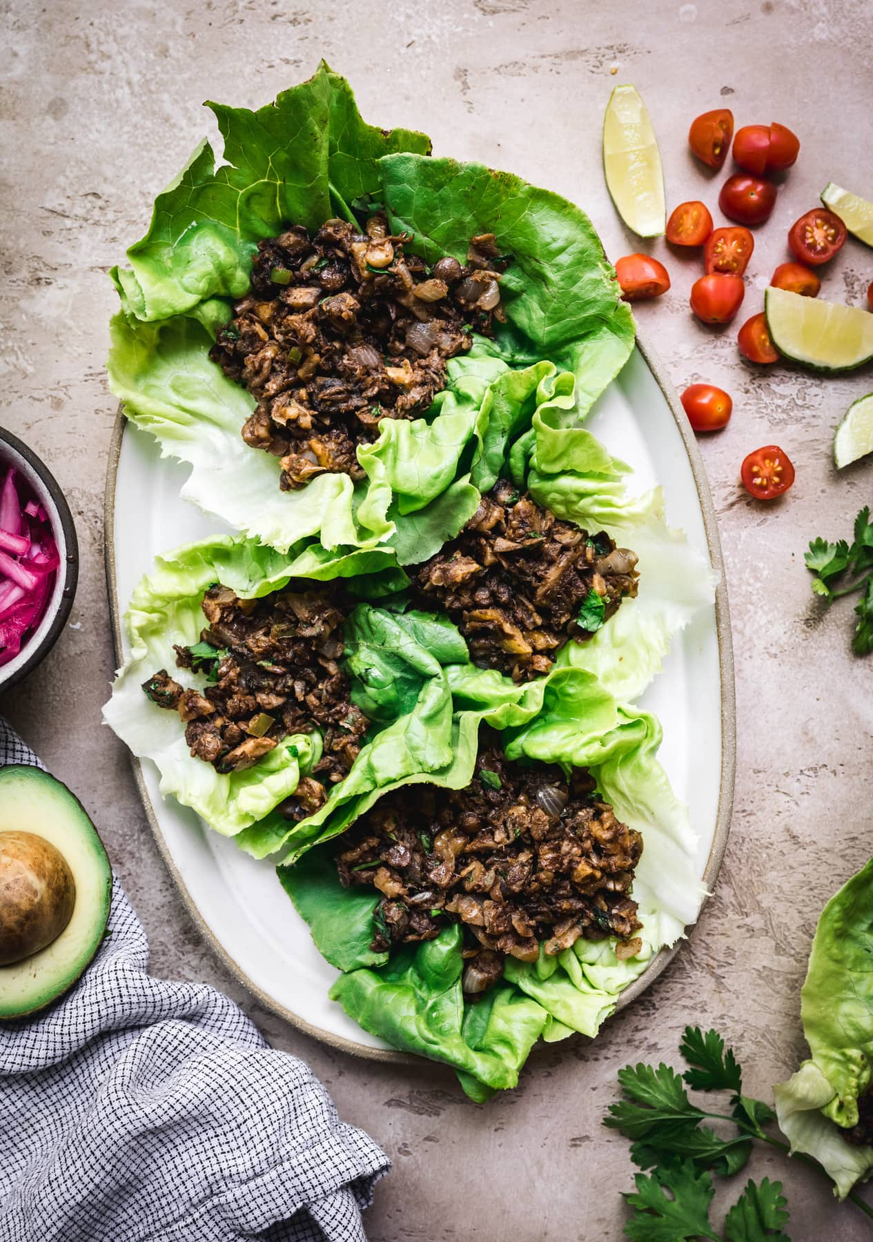 overhead of lettuce leaves filled with vegan taco filling