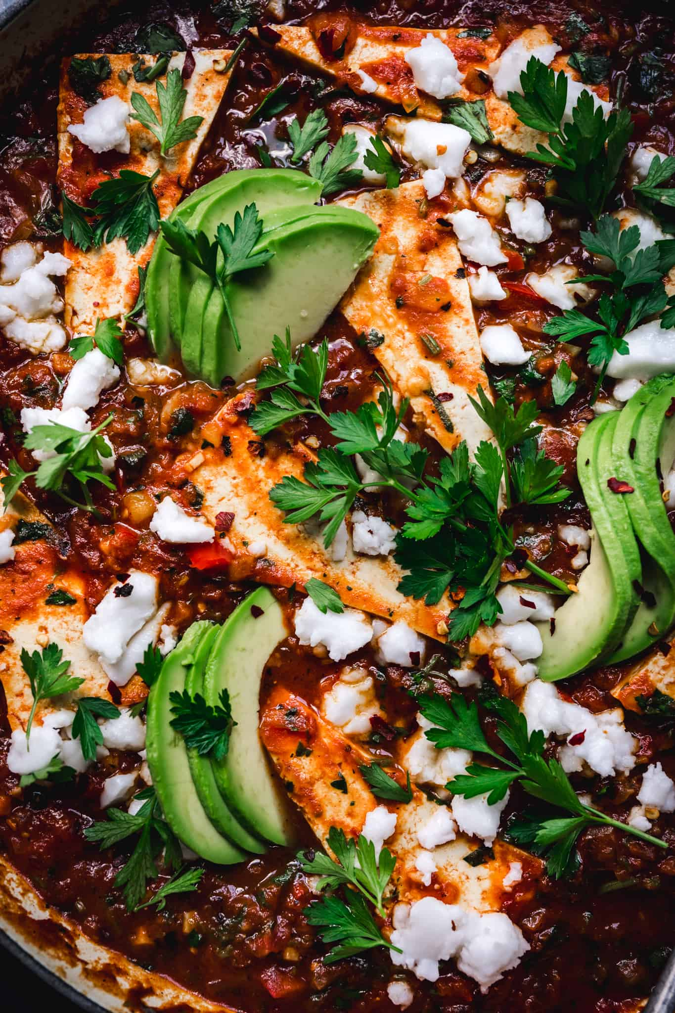 close-up of vegan shakshuka made with tofu and topped with avocado
