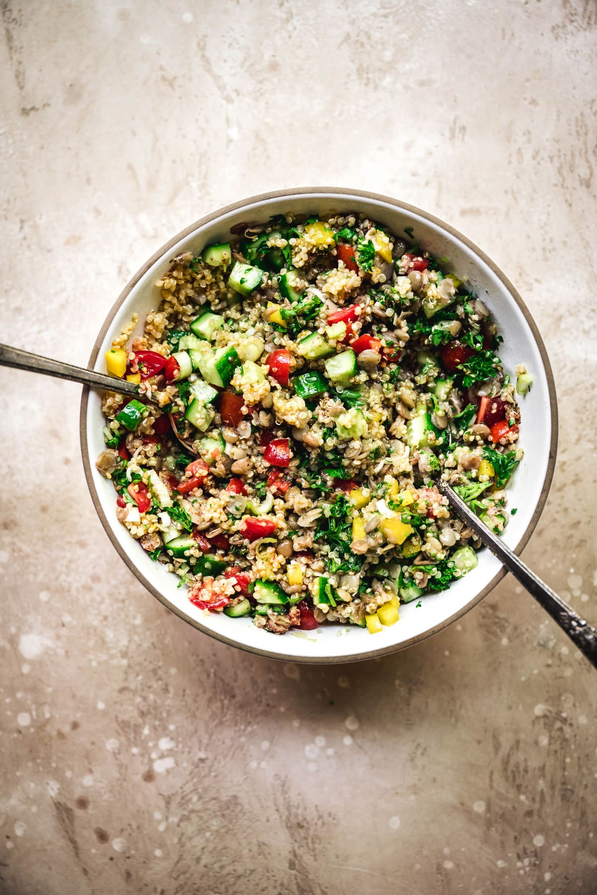 overhead view of mediterranean quinoa salad in bowl