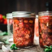 side view of tomato bruschetta in a jar