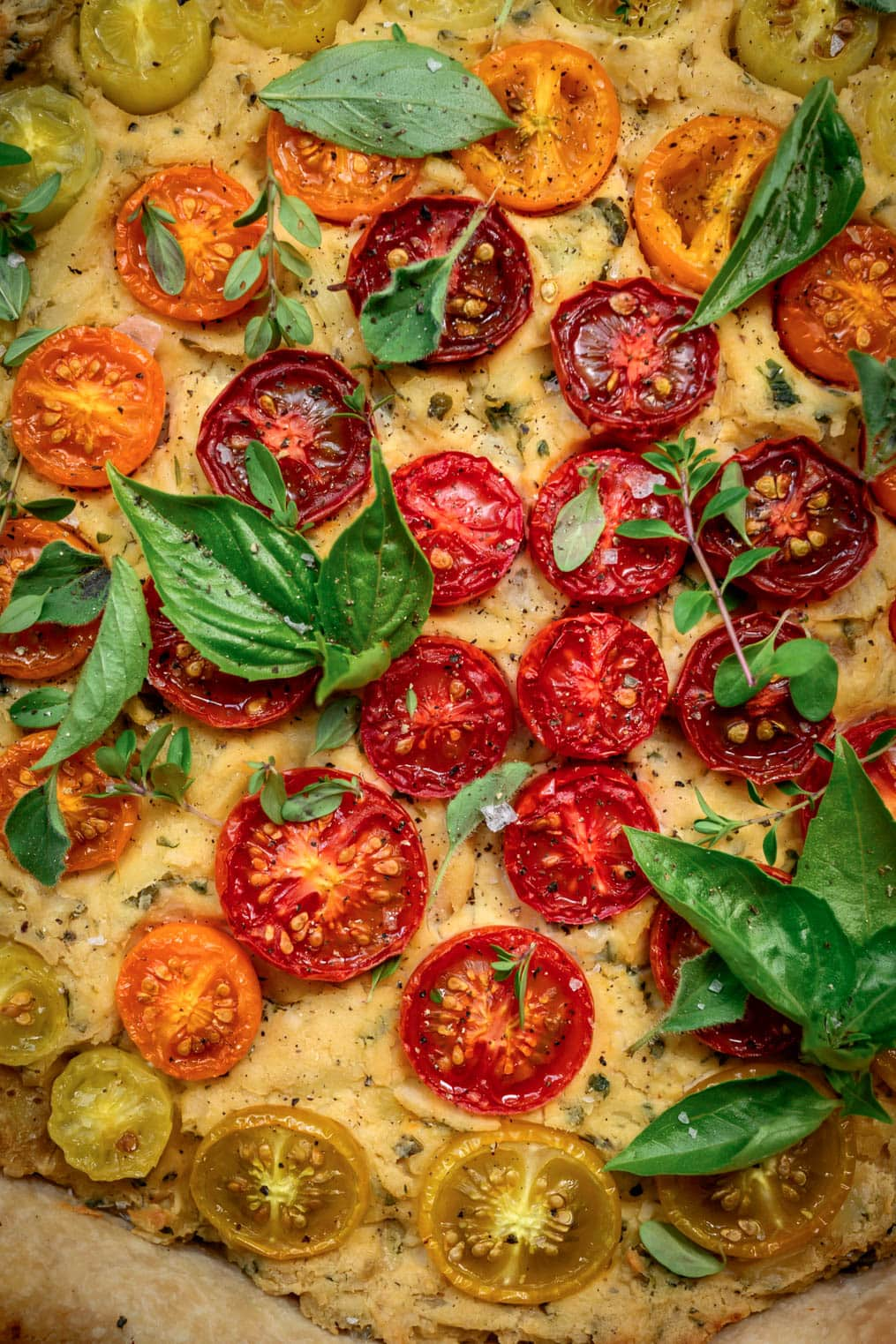 close up overhead of cherry tomatoes on a vegan quiche