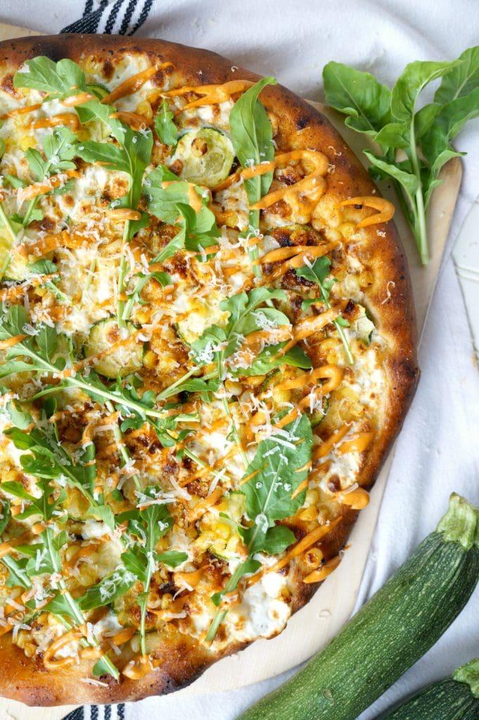 overhead of zucchini and corn pizza