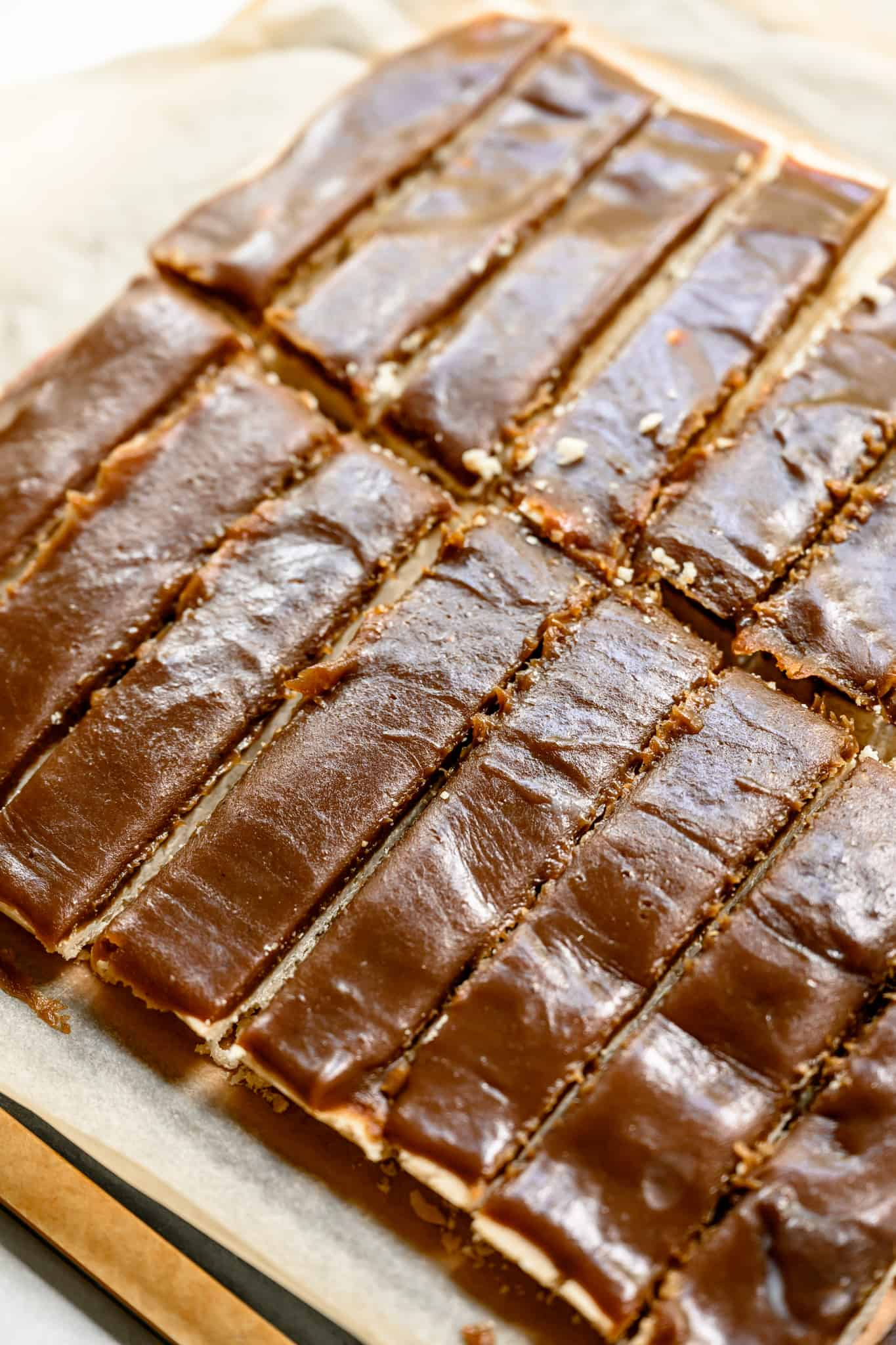 side view of vegan and gluten free twix bars with vegan caramel layer