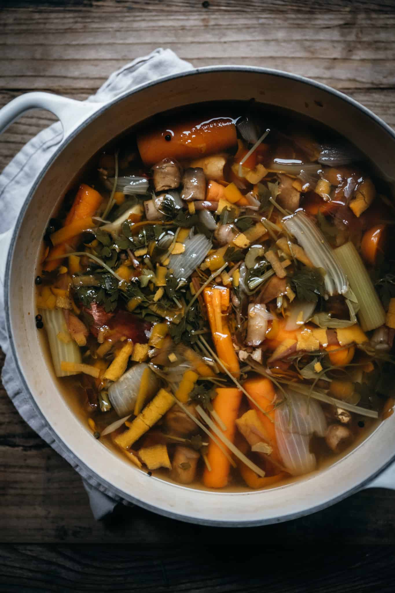 overhead view of cooked homemade vegetable broth in a large pot