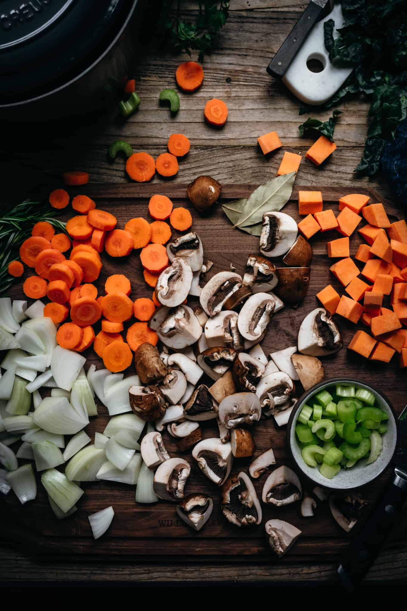 fall vegetables on a cutting board on wood table