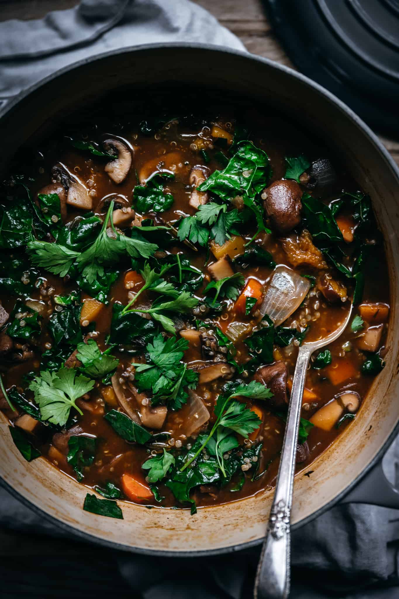 overhead of vegetable quinoa mushroom stew in a large dutch oven