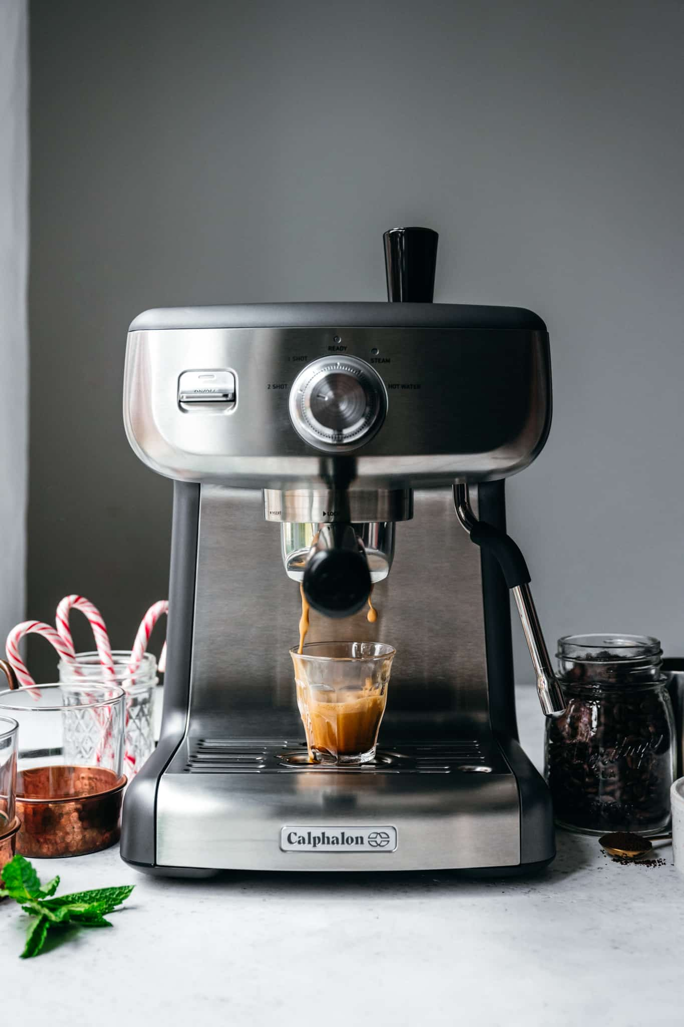 Action shot of espresso going into small mug