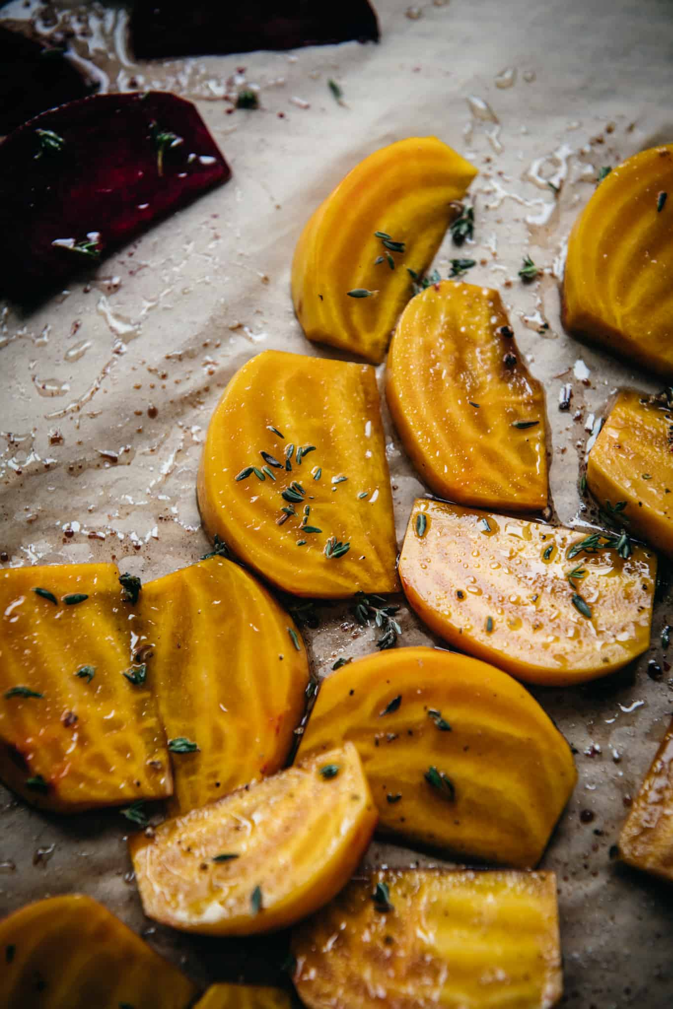 close up side view of golden beets sliced into wedges and drizzled with olive oil
