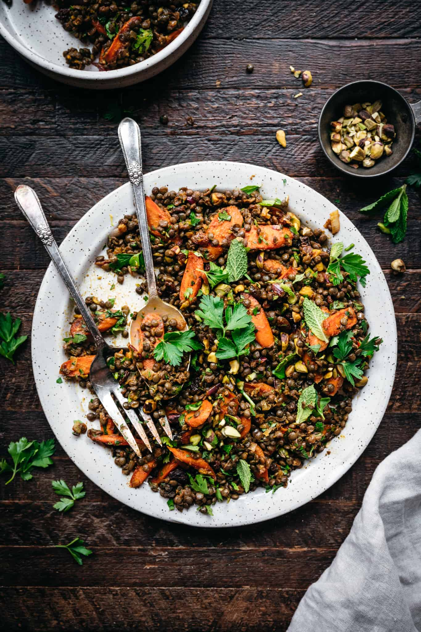 overhead view of vegan french lentil salad with roasted carrots on white plate