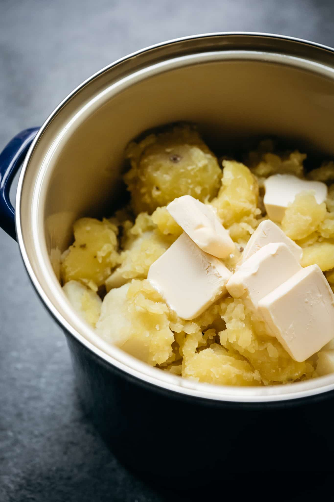 side view of boiled potatoes with vegan butter