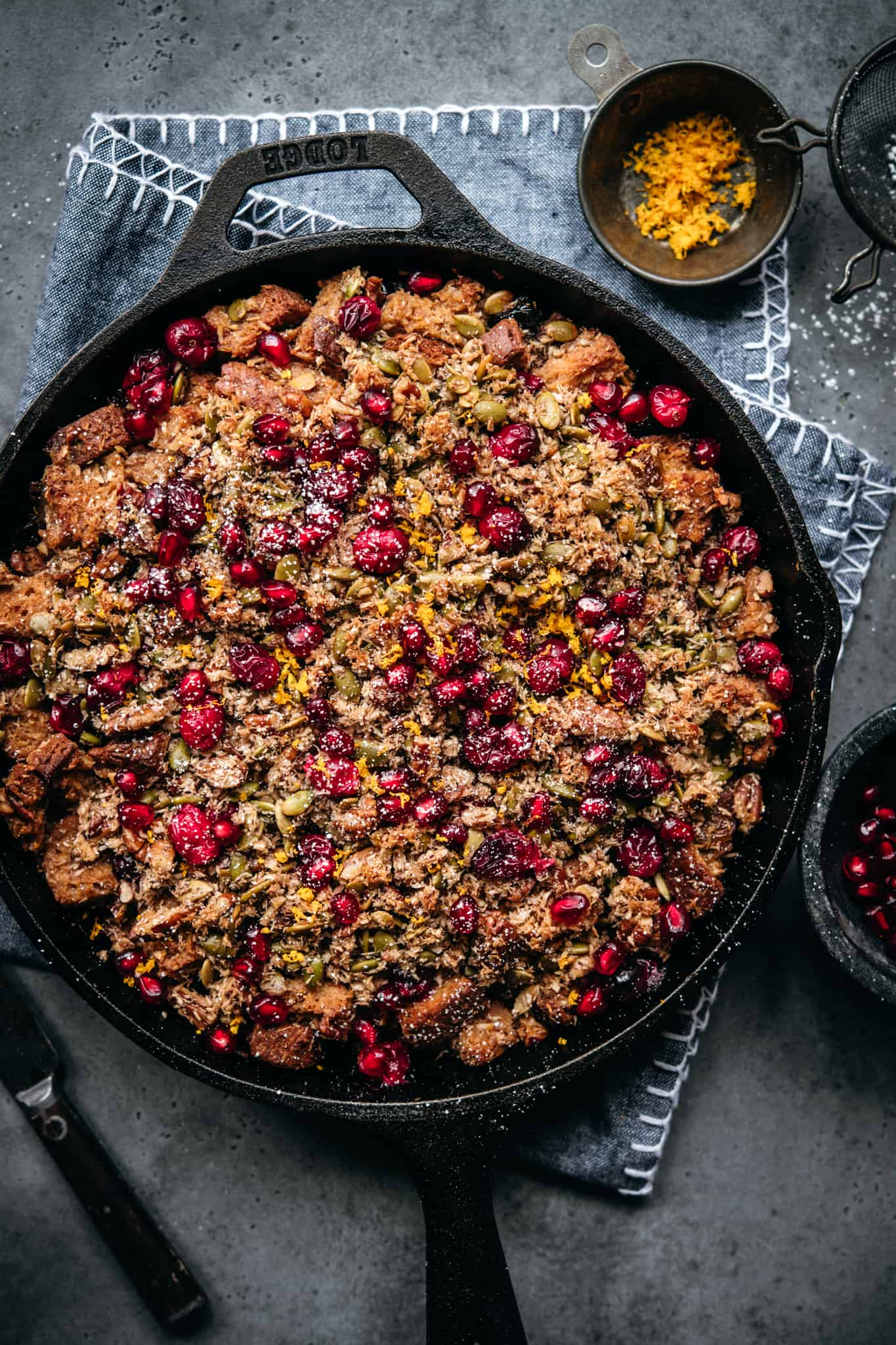overhead view of gluten free cranberry cardamom bread pudding in skillet