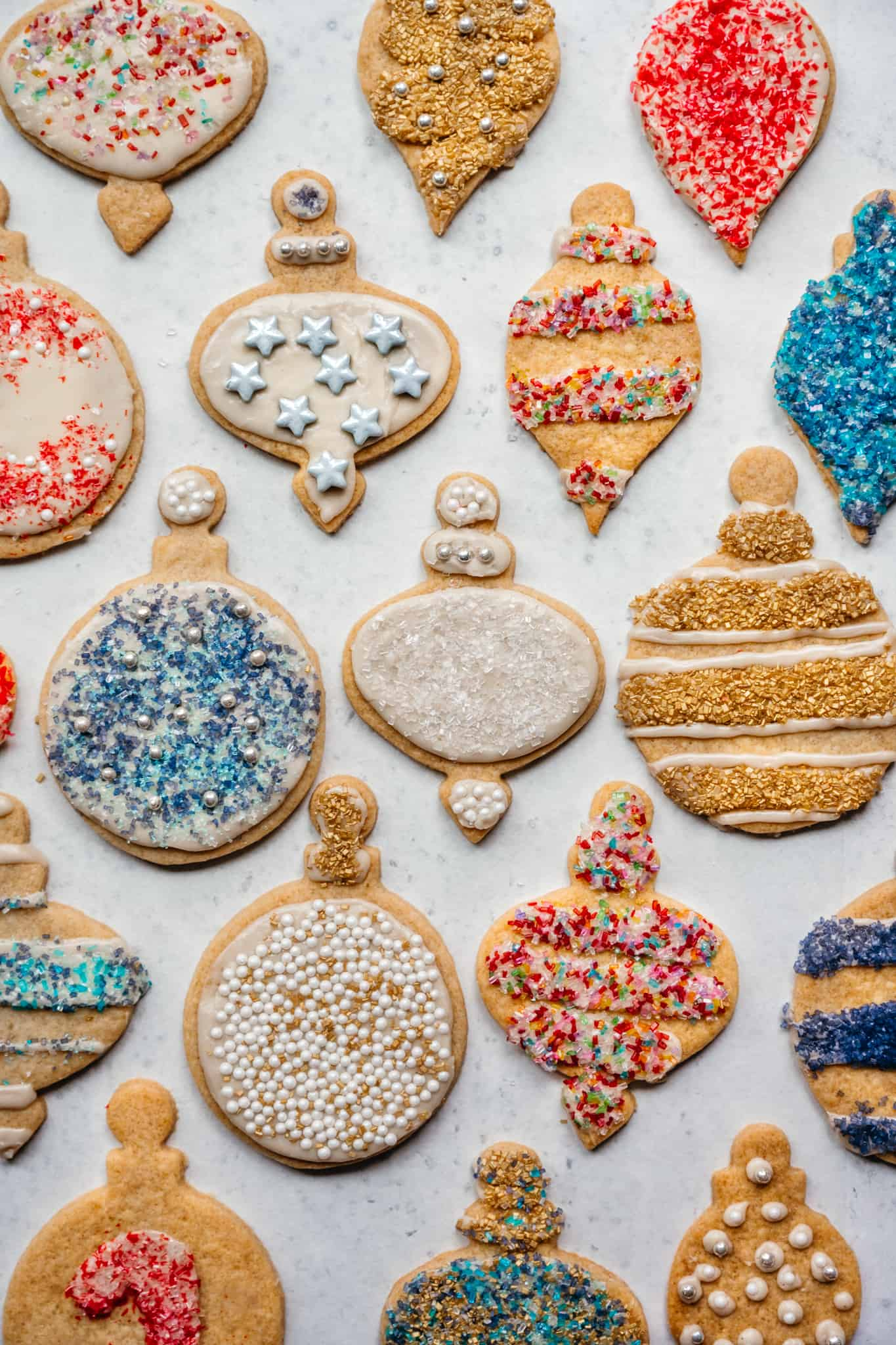 overhead view of vegan gluten free sugar cookies with christmas decorations