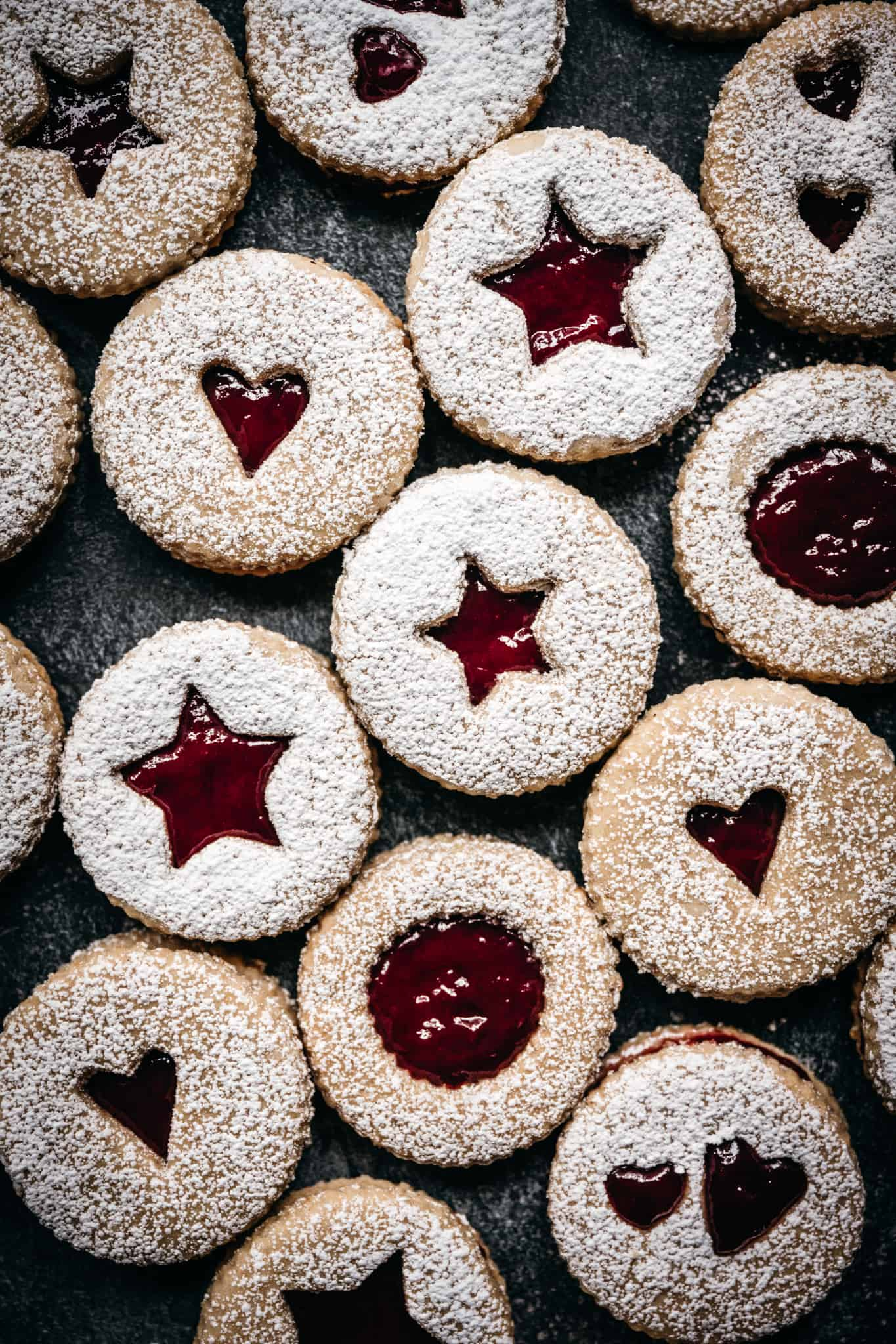 overhead view of vegan linzer cookies with powdered sugar on top