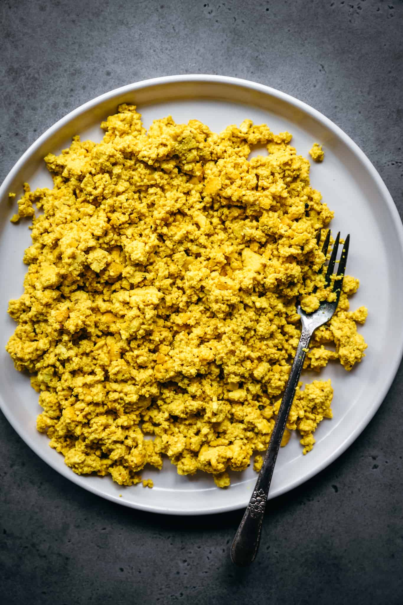 overhead view of scrambled tofu on a white plate