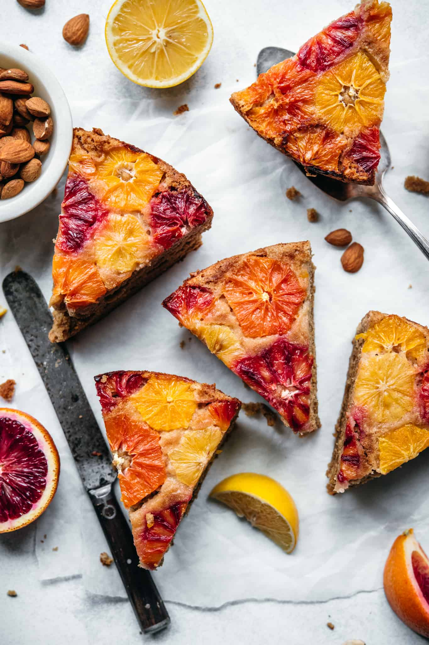 overhead view of slices of gluten free and vegan olive oil cake with citrus on top