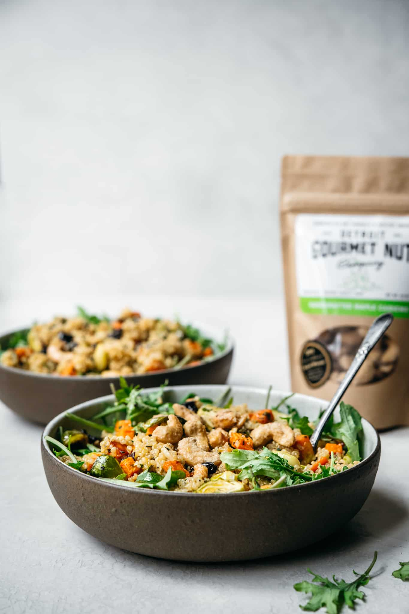 side view of vegan quinoa salad with vegetables and cashews
