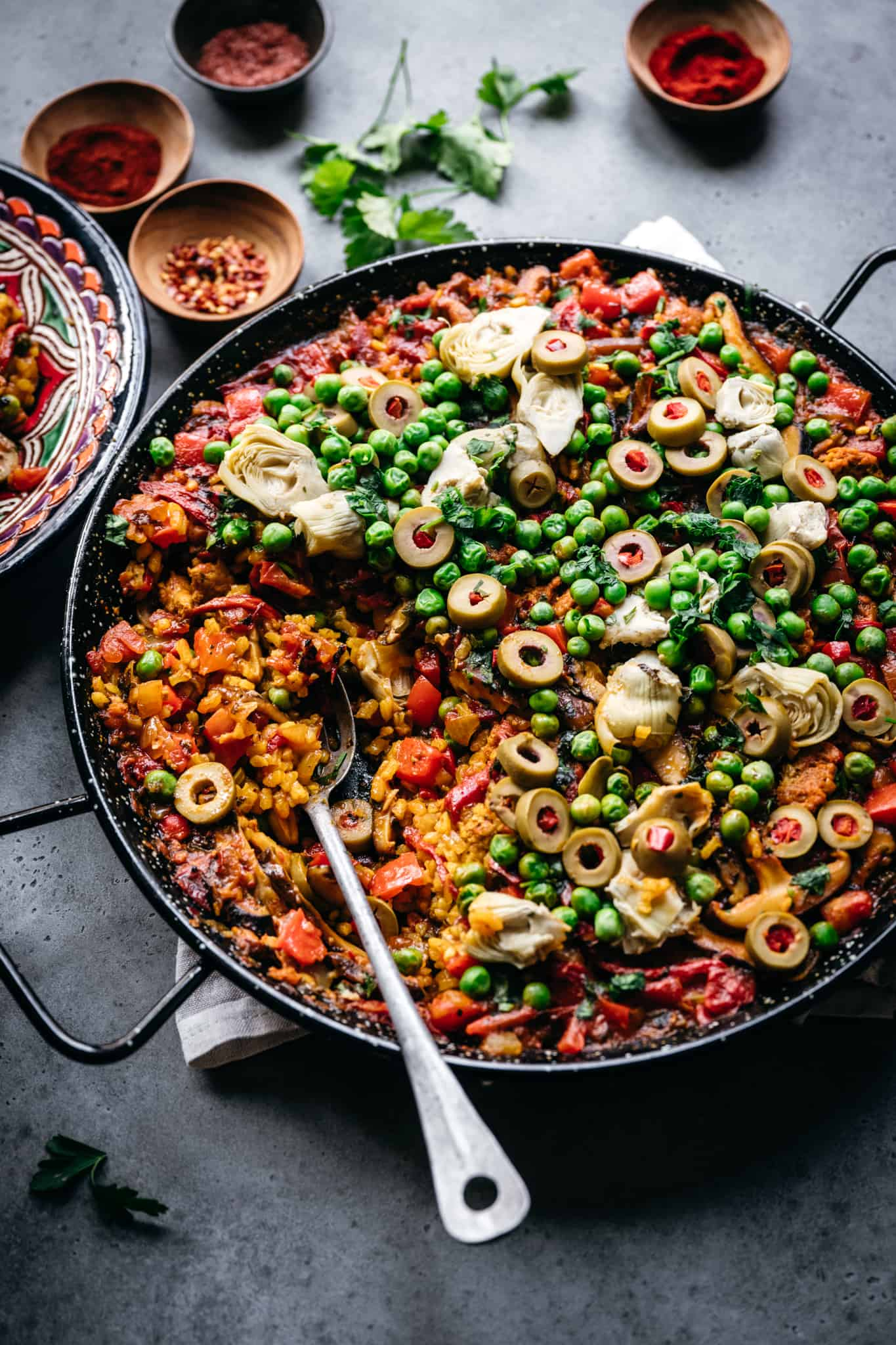 side view of vegan paella with vegetables in pan