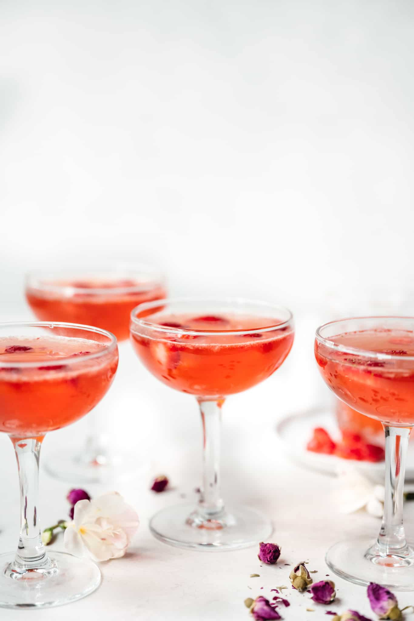 side view of strawberry vodka Valentine's Day cocktail in coupe glasses