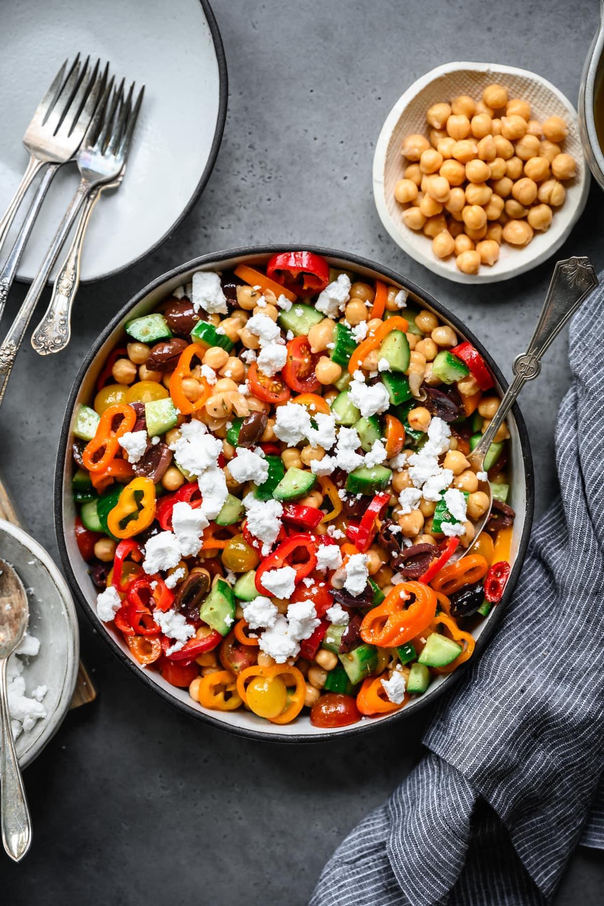 overhead view of vegan greek chickpea salad in bowl
