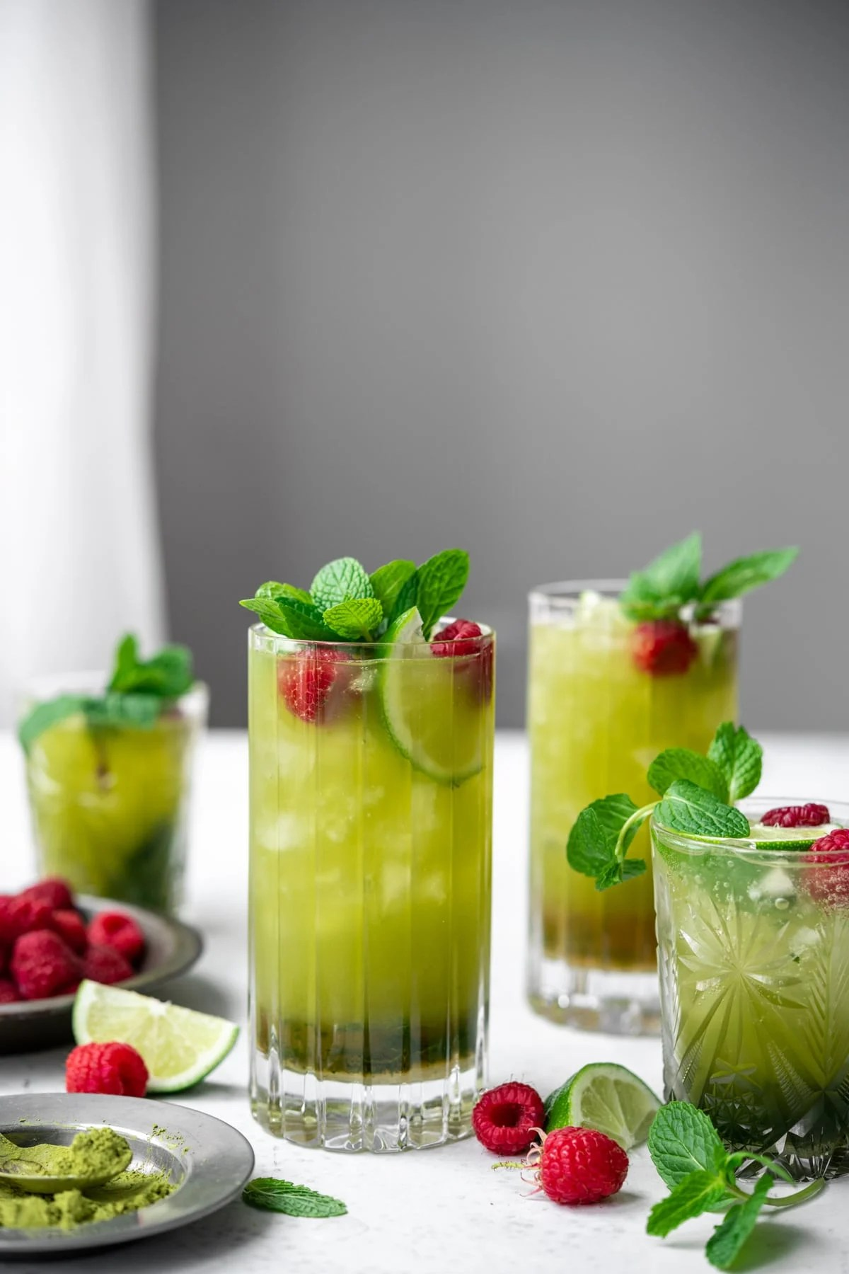 side view of glasses of matcha mojitos