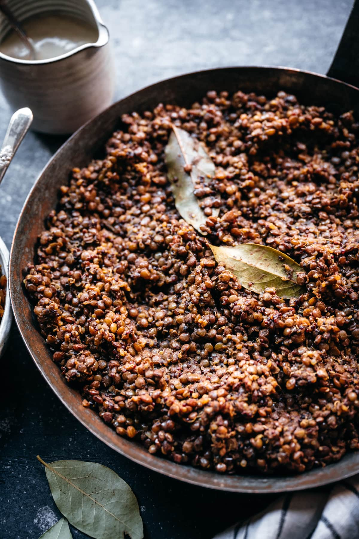 side view of middle eastern cooked lentils and quinoa