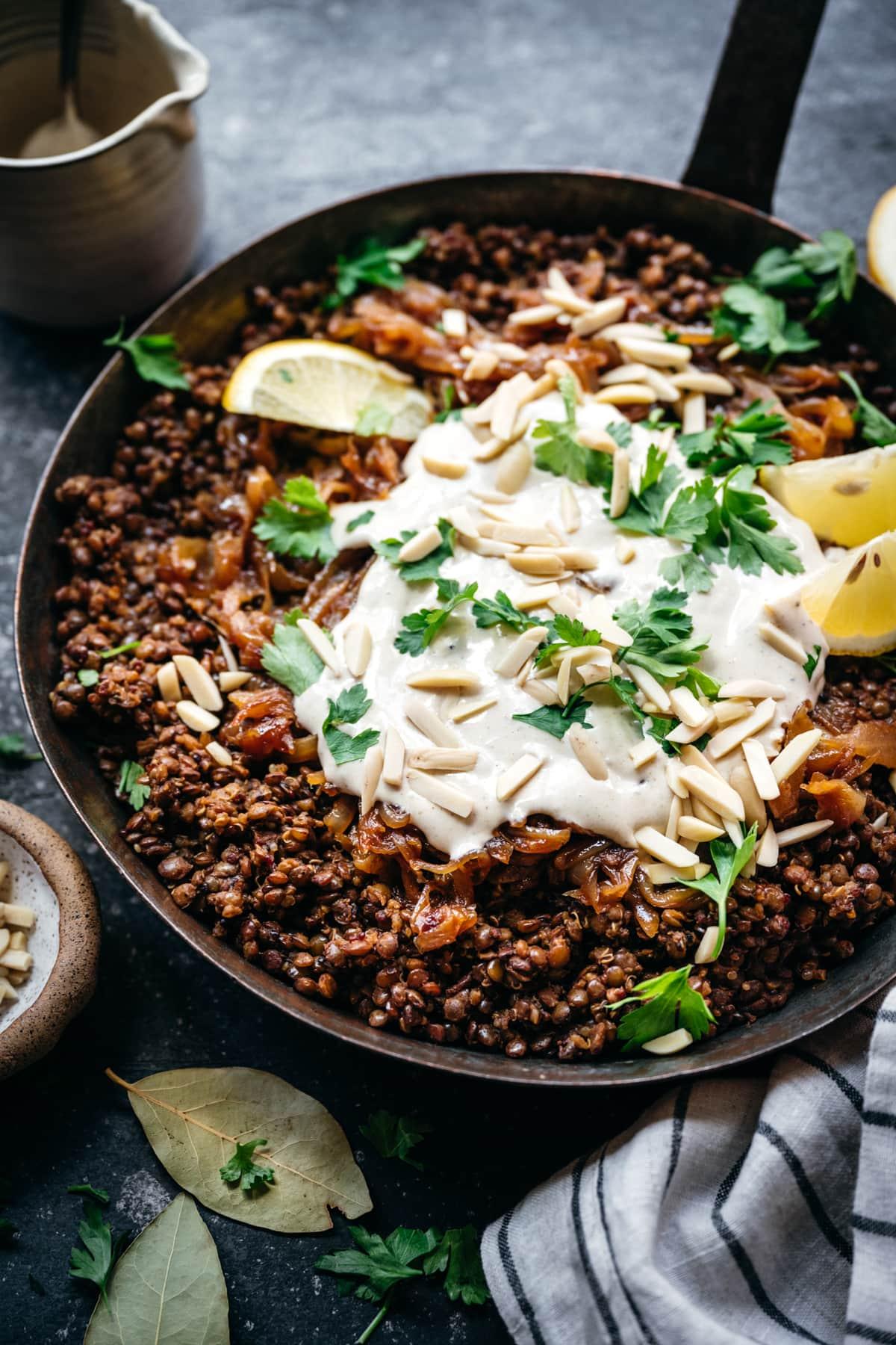 side view of vegan lentil and quinoa mujadara in a pan