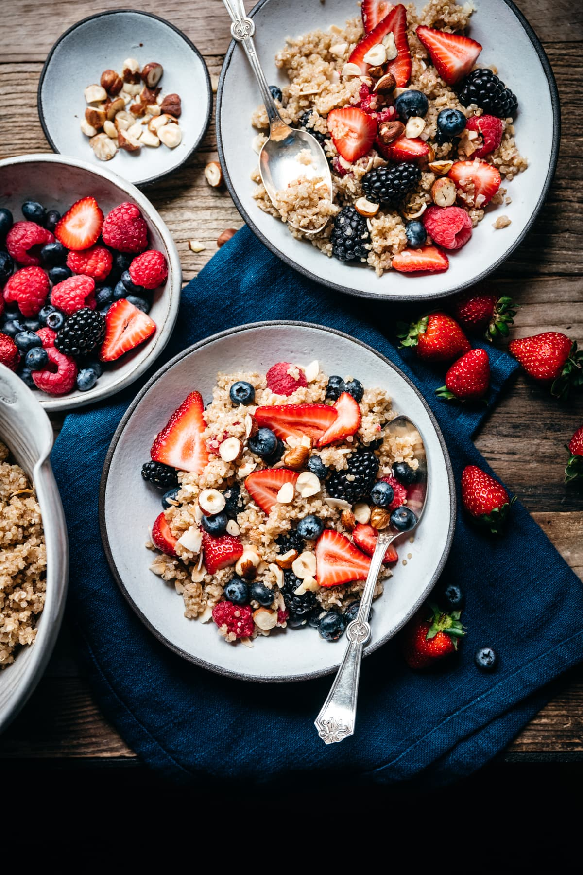 vegan breakfast quinoa with berries and coconut on wood table