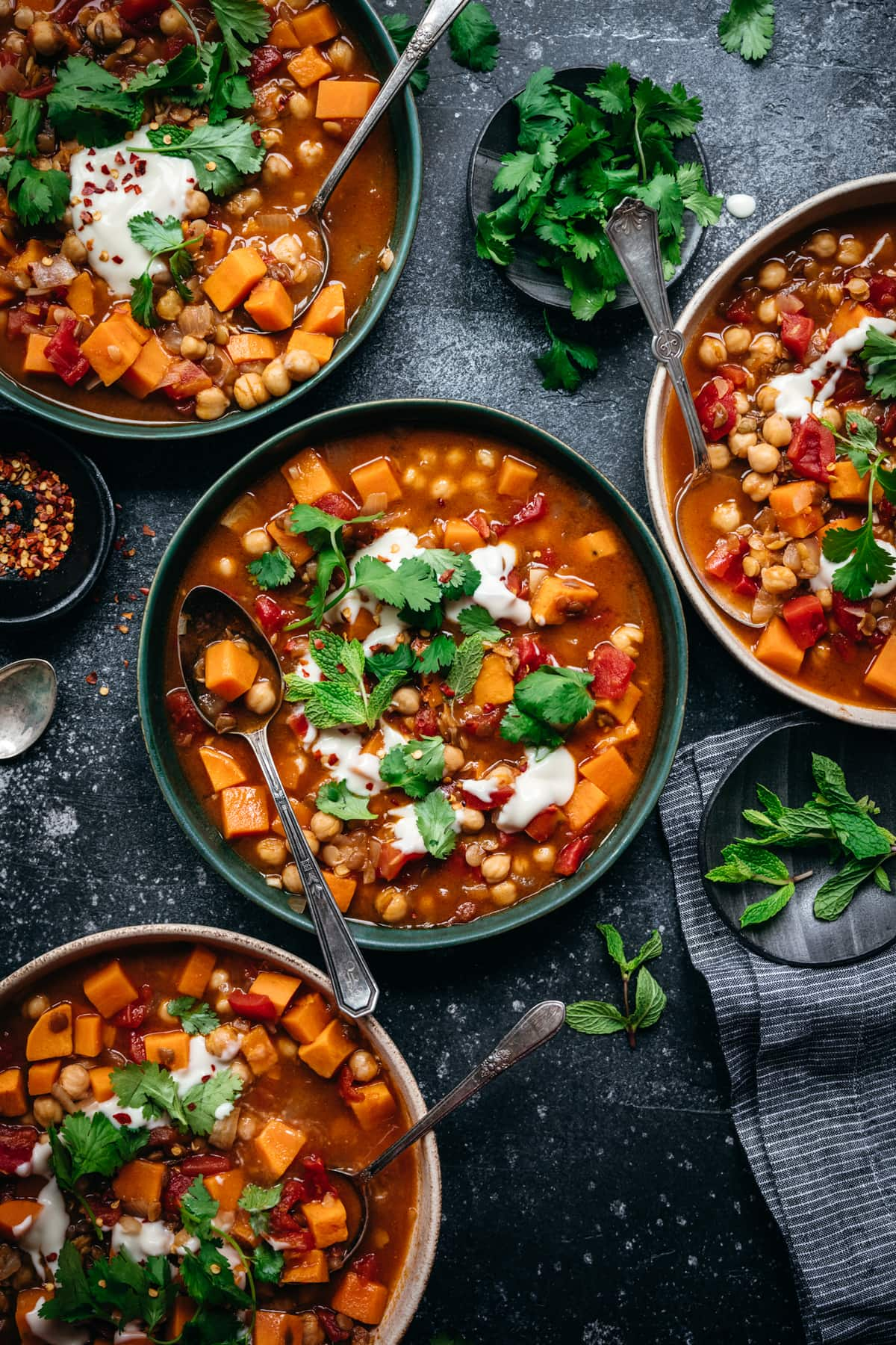 overhead view of vegan Moroccan chickpea lentil stew in bowls