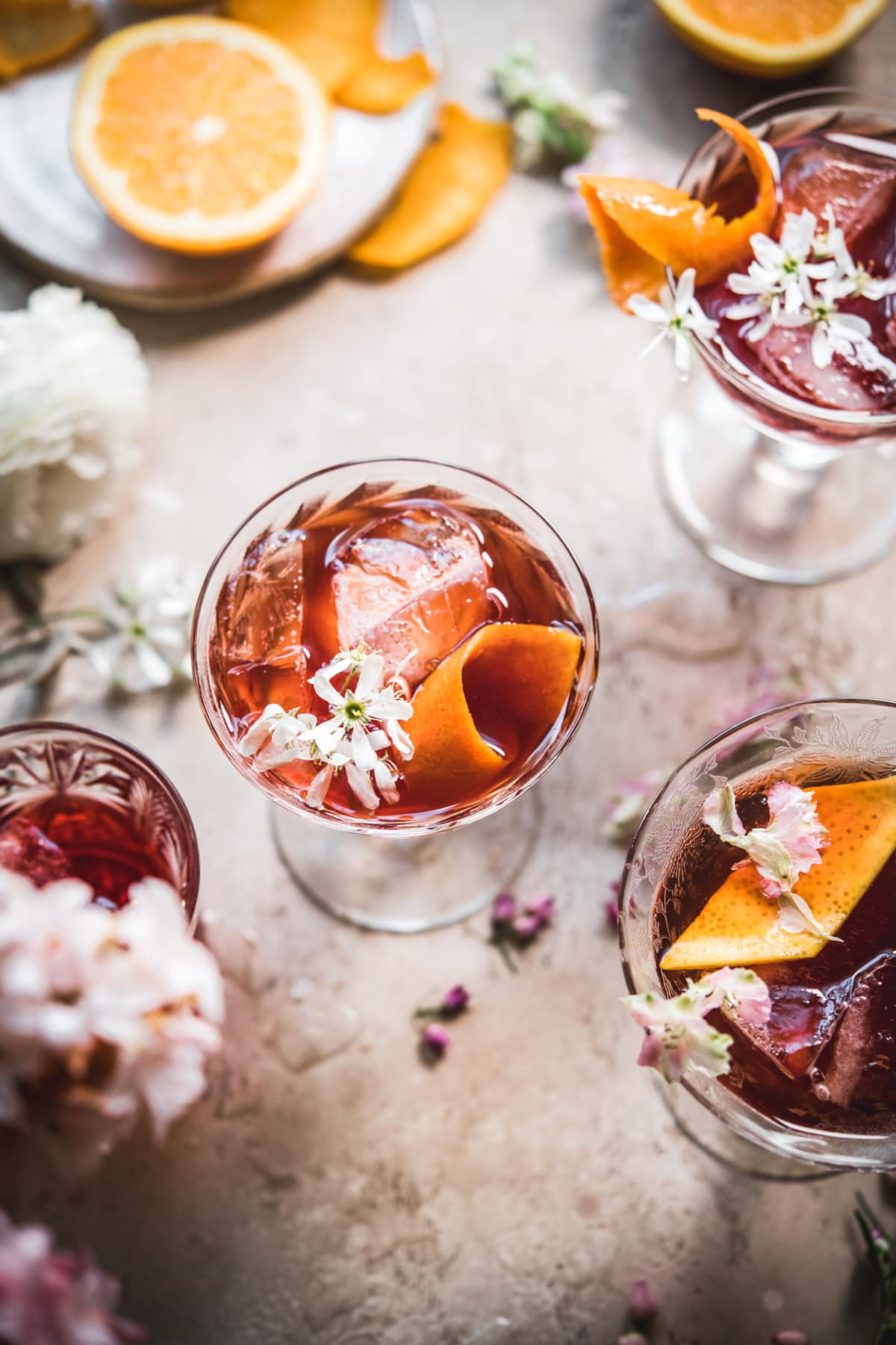 overhead view of cherry negroni with orange peel
