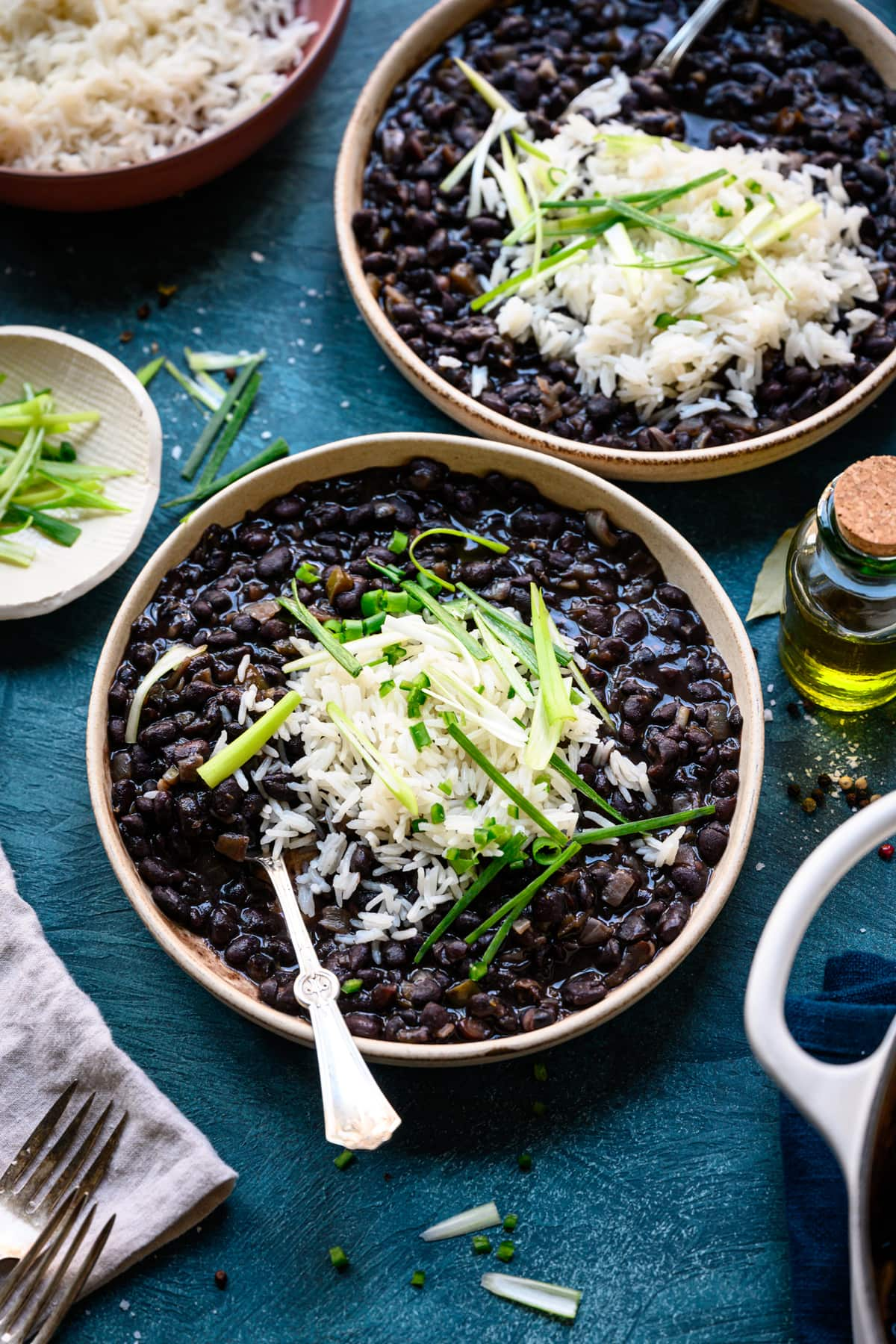 side view of cuban black beans in bowl with rice