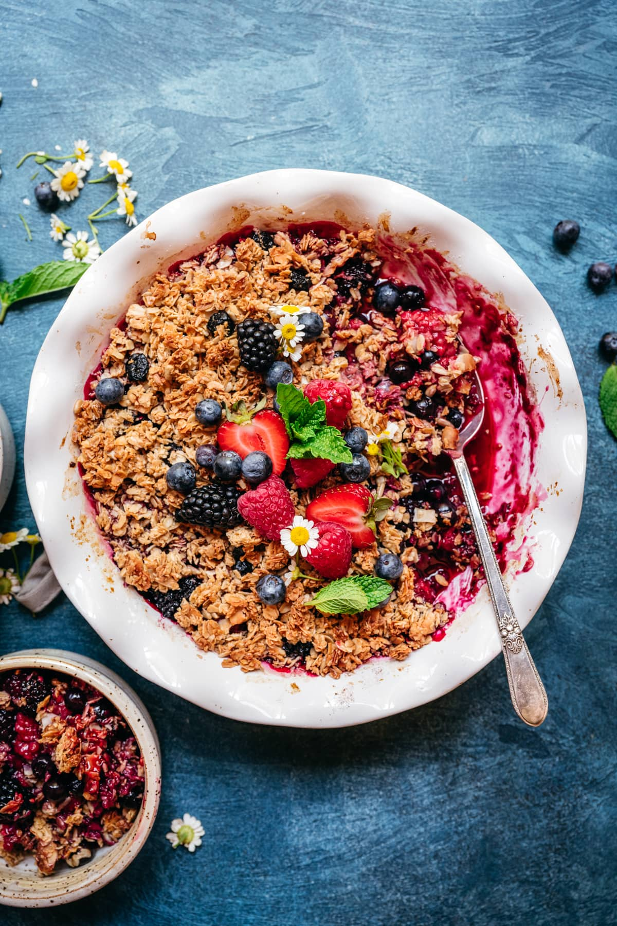 overhead view of vegan gluten free triple berry crisp with granola
