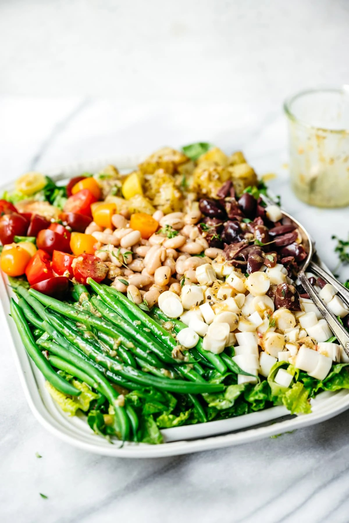 side view of vegan nicoise salad on a platter