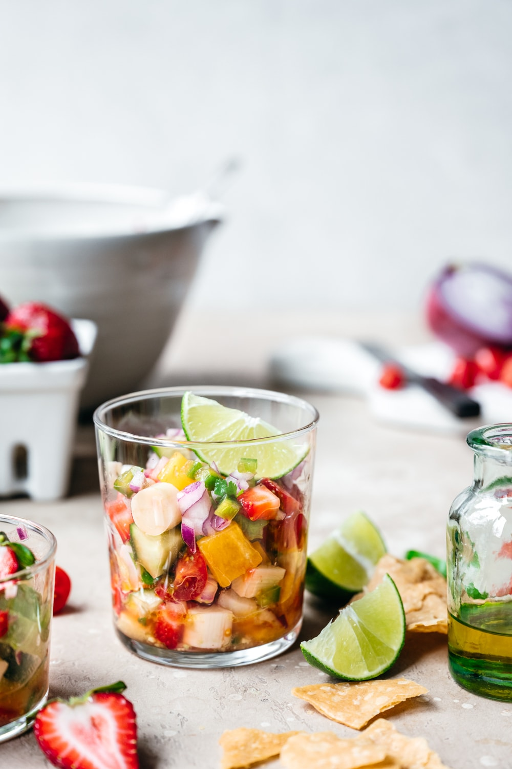 side view of vegan ceviche in a glass jar with lime slice