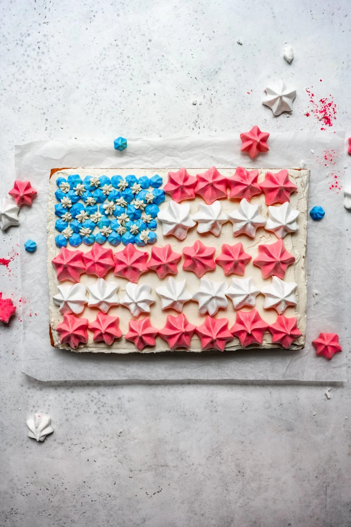 overhead view of vegan flag cake with meringues