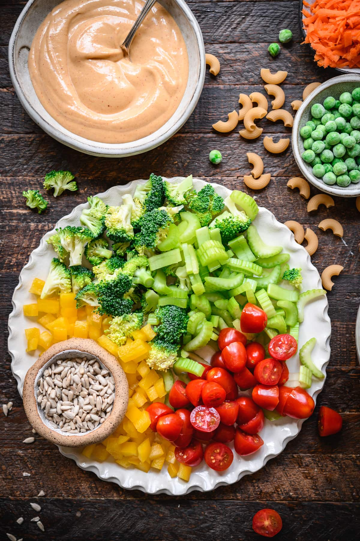 overhead view of ingredients for vegan macaroni vegetable salad