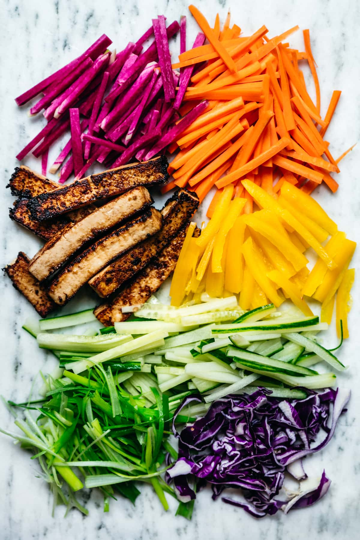 overhead view of colorful raw vegetables prepared for wraps