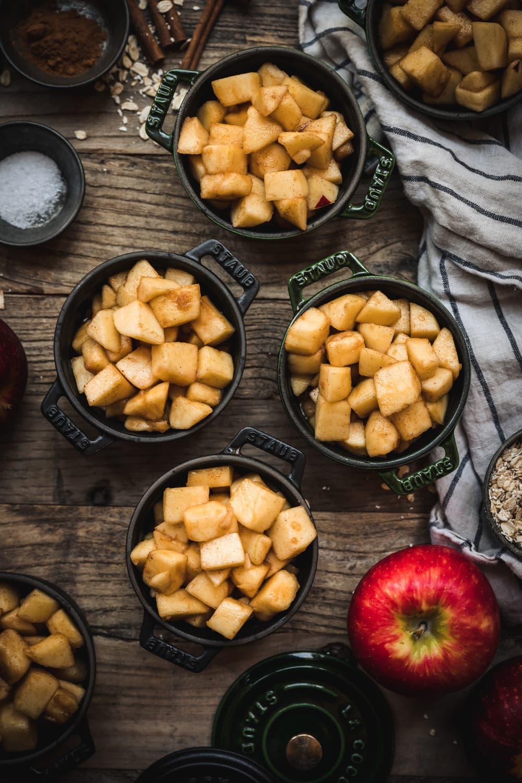 overhead view of apple filling for crisp in ramekins