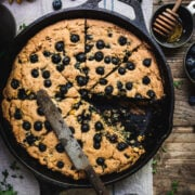 overhead of gluten free blueberry cornbread in a skillet