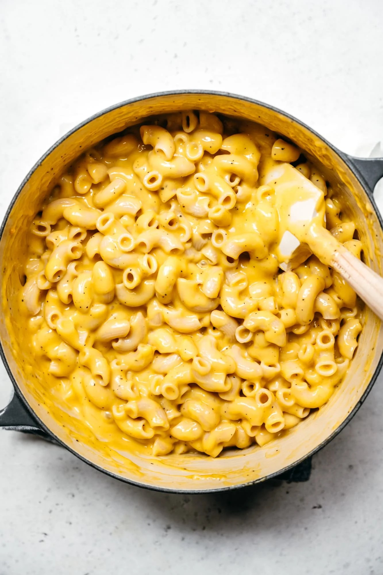 overhead view of creamy vegan mac and cheese in large pot