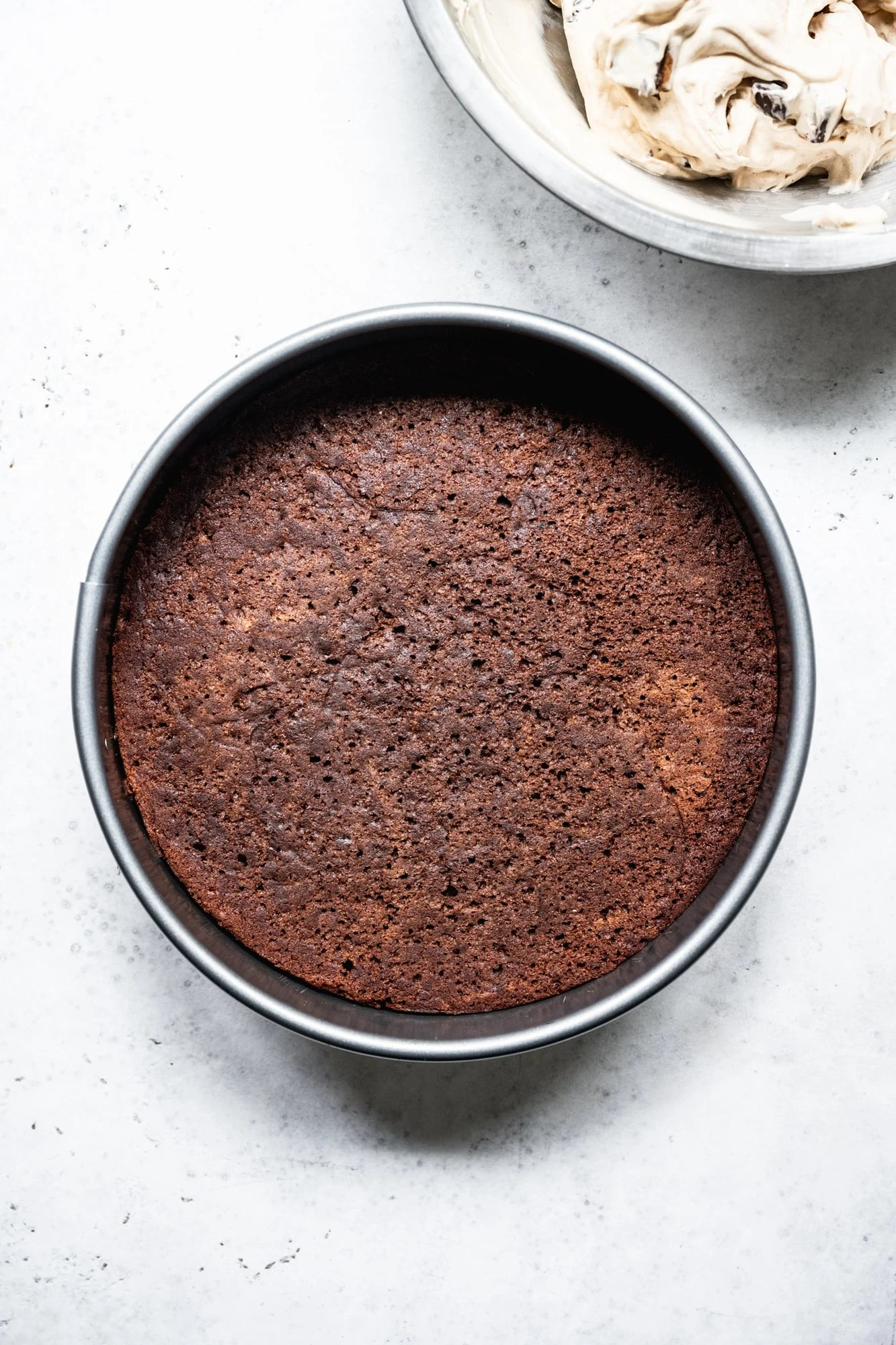 overhead view of chocolate cake in cake pan